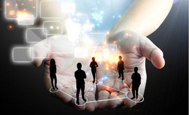 Business team in cupped hands with digital transformation context  © nopporn - shutterstock