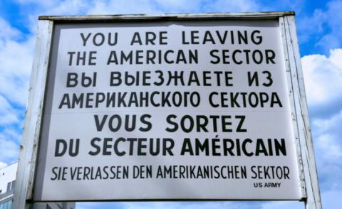 Information sign at the Former Checkpoint Charlie, inner-city border crossing West Berlin to East Berlin © footageclips - Shutterstock